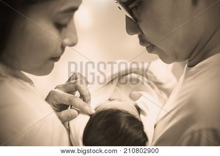 Asian Parents With New Born Baby Close Up Portrait Of Asian Young Couple Holding Their New Born Baby