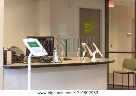 Check-in Kiosk Tablet At Front Desk Of Diagnostic Testing