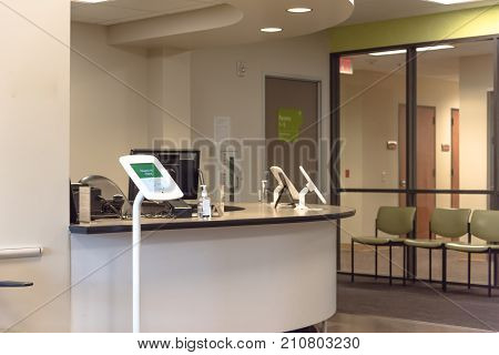 Check-in Kiosk Tablet At Front Desk Of Diagnostic Testing