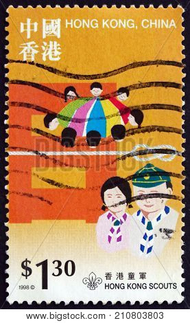 HONG KONG CHINA - CIRCA 1998: a stamp printed in Hong Kong shows Grasshopper scouts and Cub scouts different scouting divisions circa 1998