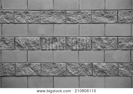 Stony wall background - texture pattern for continuous replicate. Seamless texture, background, stone lined with granite walls. Sandstone. stone wall backdrop. Facing stone