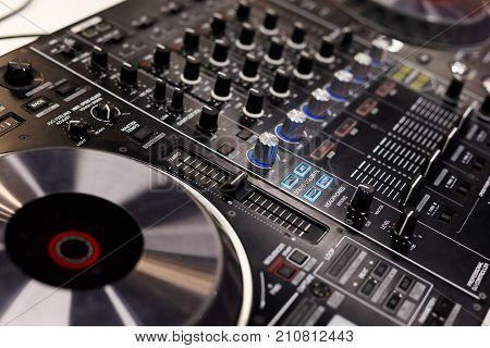 Close up of professional dj controller. Selective focus.