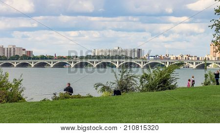 Detroit MI USA - 2 October 2016: People enjoying the outdoors on Belle Isle with the iconic MacArthur Bridge in the background. Belle Isle officially Belle Isle Park is an island park in the Detroit River between the United States mainland and Canada.