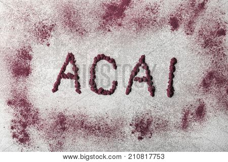 Word ACAI made of powder on table
