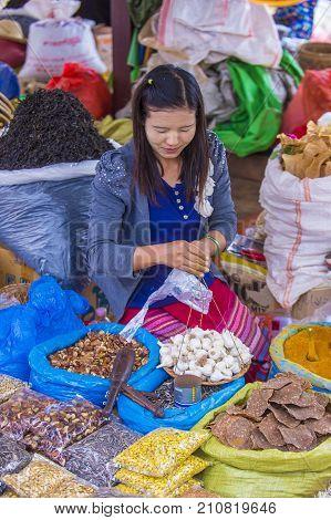 SHAN STATE MYANMAR - SEP 06 : Burmese woman selling vegetables in a market in Shan state Myanmar on September 06 2017. Agriculture is the main industry in Myanmar