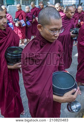 AMARAPURA MYANMAR - SEP 03 : Monks at the Mahagandayon Monastery in Amarapura Myanmaron September 03 2017 Mahagandayon Monastery has 2000 monks at any given time.