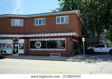 JOLIET, ILLINOIS / UNITED STATES - JULY 25, 2017: Barbers Inc. offers classic and modern haircuts, including fades, tapers, afros, mohawks, graphics, designs, linings, razor fades, and razor shaves.