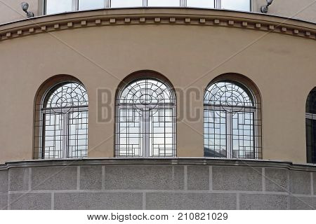 Three Arch Windows With Safety Bars Building
