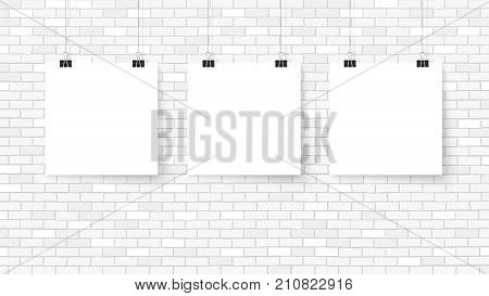 Poster on binder clips. Paper templates on brick wall. Realistic mock up. Empty frames for your business design. Brick wall. Vector template for lettering quote images or logos.