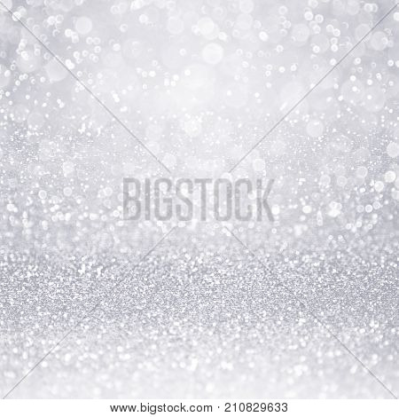 Abstract elegant shiny silver white glitter sparkle background or confetti party invite for wedding, happy birthday, frozen winter ice snow flake, Christmas or anniversary texture