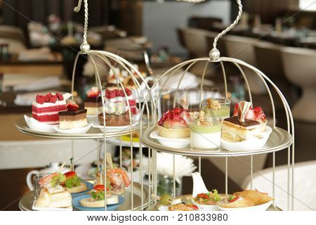Afternoon tea served with an assortment of cakes