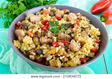 Warm dietary salad from baked vegetables (zucchini sweet pepper eggplant onion) chicken and couscous. Tabbouleh - Eastern snack.