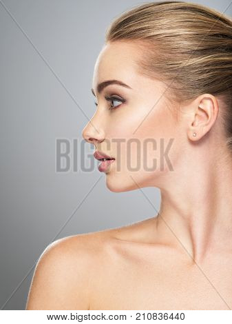 Profile face of  young  woman, skin care treatment. Side view of beautiful girl with healthy skin of the face