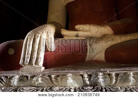 An historic Buddha statue in a temple in Bagan in central Burma in the Bhumisparsa Mudra or earth-witness pose