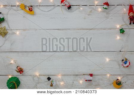Top view of decoration Happy New year and Merry Christmas background.Mix variety essential of accessory for season.Different object on modern rustic white wood office desk.space for creative word.