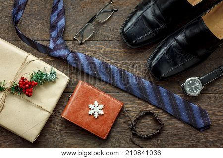 Table top view of accessories men fashion to travel with decorations & ornaments merry Christmas & Happy new year festival concept.Essential items prepare for traveler adult or teen at season.
