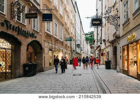 Salzburg, Austria - August 6, 2017: Getreidegasse. Scenic cityscape of historical city centre of Salzburg with a crowd of people walking