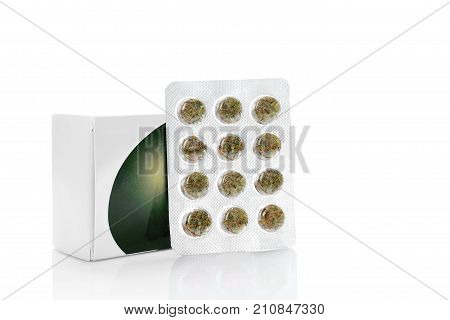 Medical Marijuana in blister pack isolated on white. Natural remedy. Alternative medicine medicinal plant.