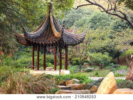 Wooden pavilion in the chinese garden. Tiger Hill, Suzhou, China