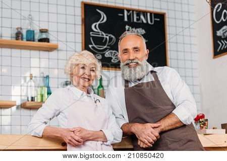 Coffee Shop Owners Standing At Counter