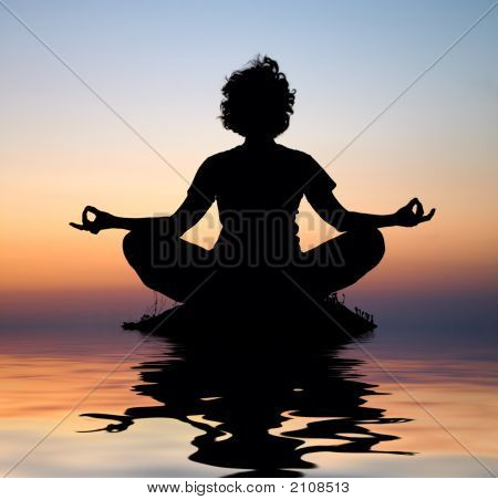 Evening Yoga Meditation In Padmasana In The Middle Of Water