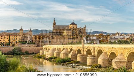 CORDOBA,SPAIN - OCTOBER 1,2017 - View at the Mosque - Cathedral with Old Roman bridge in Cordoba. Cordoba is a city in Andalusia southern Spain and the capital of the province of Cordoba.