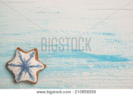 Tasty gingerbread cookie on wooden table ober shabby wood