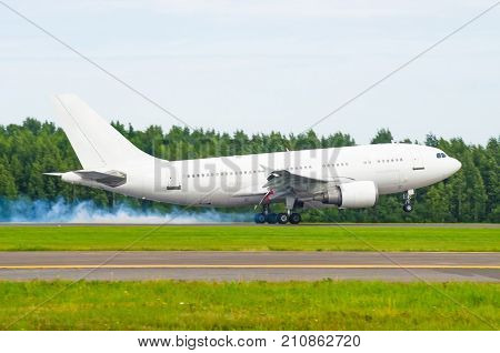 Airplane Landing On The Runway At The Airport With Smoke From The Chassis. Hard Landing.