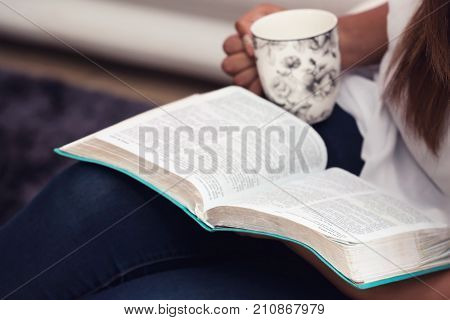 Close Up Of Young Lady Studying Her Bible