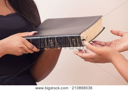 Girl Giving A Bible And Spreading The Good News