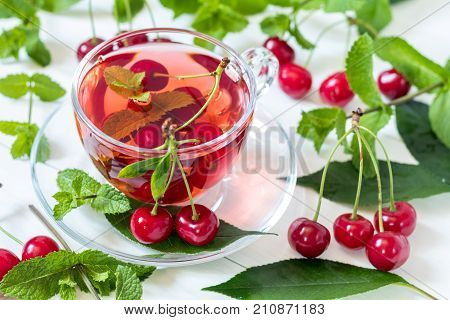 Fruit Cherry Drink In Transparent Glass Cup