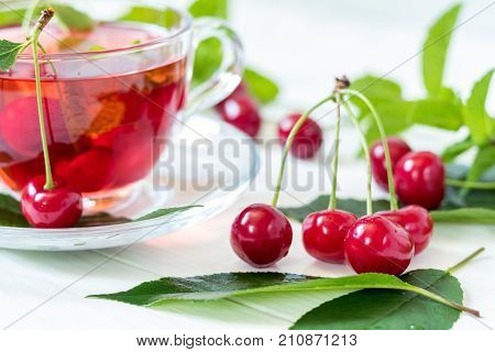 Cherries And Cherry Flavored Drink In Glass Cup