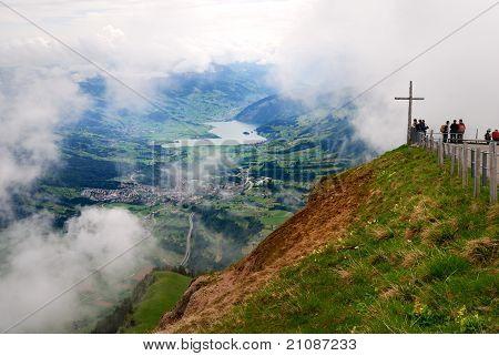 A wooden cross standing on top of Rigi mountain in Switzerland