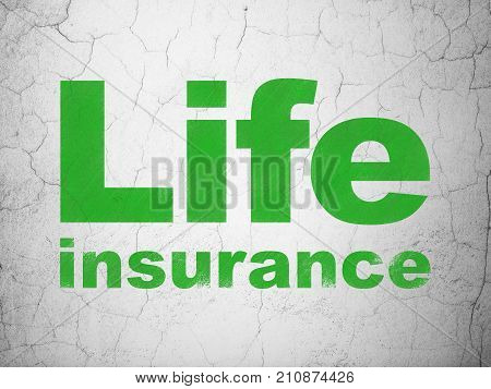 Insurance concept: Green Life Insurance on textured concrete wall background