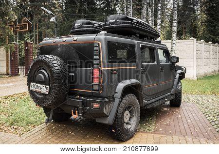 Black Hummer H2 Car Stands On Rural Parking