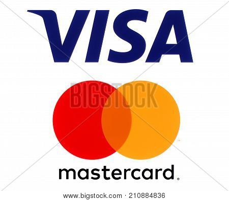 Kiev Ukraine - September 30 2017: Visa and Mastercard logos printed on white paper. Visa and Mastercard are an American multinational financial services corporations
