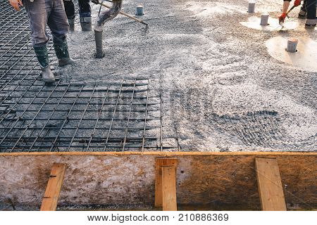 Concrete pouring during commercial concreting floors of buildings in construction - concrete slab, foundations