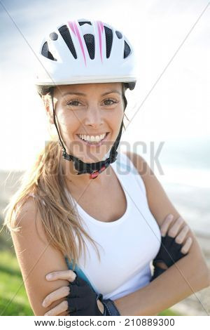 Portrait of smiling woman on bike ride with helmet on