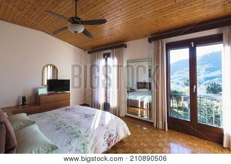 Bedroom with floor and wooden ceiling, very vintage