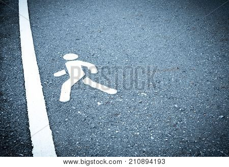 White painted sign on asphalt. People are going to step into the finish line. Do not be afraid to step over obstacles concept. pedestrian lane