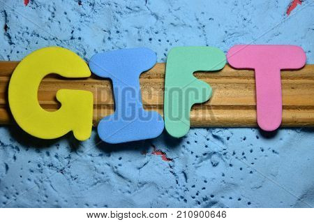 word gift on a  abstract blue background