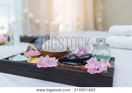 Thai Herbal Compress hot stones salt water prepared on massage table for Thai traditional massage and spa treatment