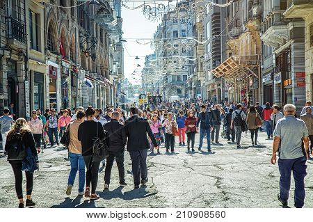 ISTANBUL TURKEY: Crowds of people walking along Istiklal Avenue on October 6 2017. Istiklal is one of the most famous avenues in Istanbul visited by nearly 3 million people in a day