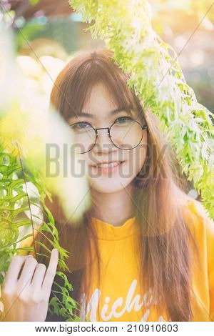 Asian teen cute waring glass slim white skin portrait with green nature