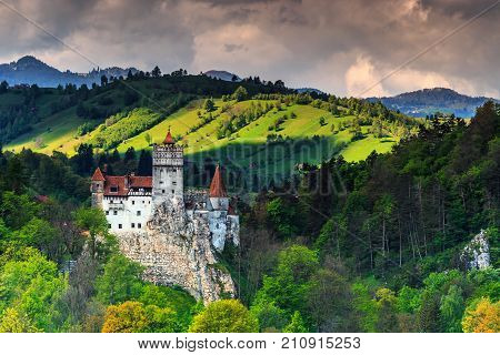 Stunning Bran castle and cloudy summer landscape, Transylvania, Romania, Europe
