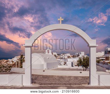 Oia Village, Santorini Cyclade islands, Greece. Beautiful view of a white church in caldera.
