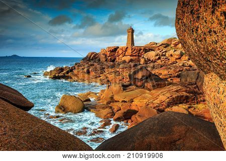 Spectacular sunset with lighthouse of Ploumanach Mean Ruz in Perros-Guirec on Pink Granite Coast, Brittany, France, Europe poster