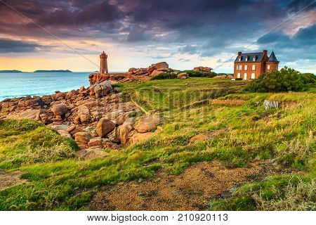 Amazing sunset with lighthouse of Ploumanach Mean Ruz in Perros-Guirec on Pink Granite Coast, Brittany, France, Europe poster