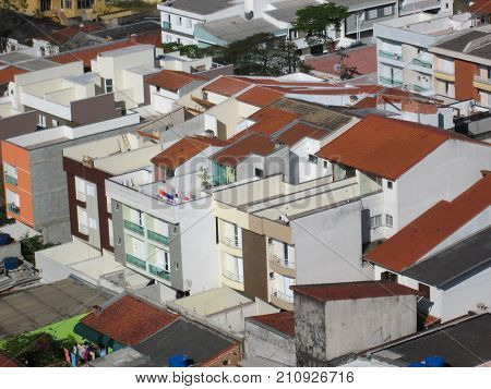 Small residential buildings side by side in a dense district