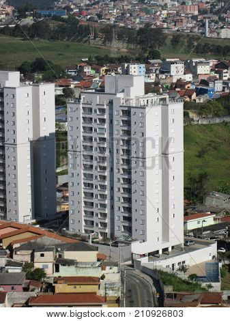 Residential building amid houses in the suburban area